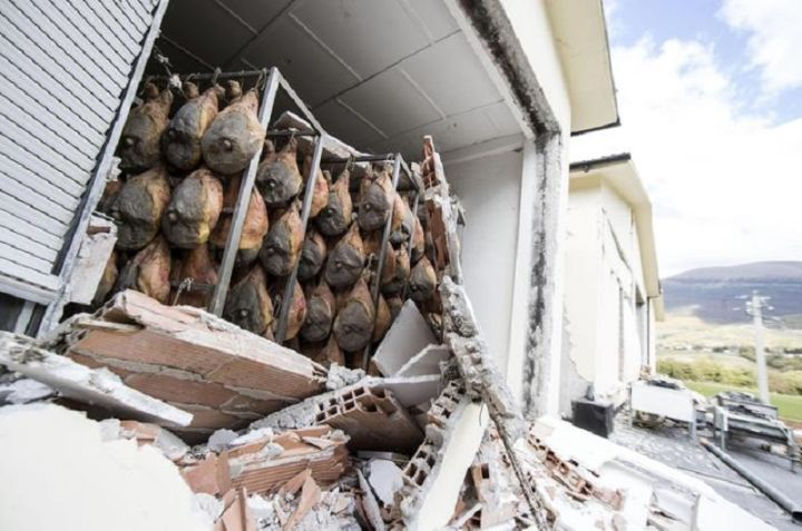 Hanging hams are seen inside a damaged ham factory in Norcia, 02 November 2016. Aftershocks continue to keep people on edge in the areas of central Italy devastated by a series of recent earthquakes, including Sunday's 6.5-magnitude quake near Norcia. ANSA/MASSIMO PERCOSSI