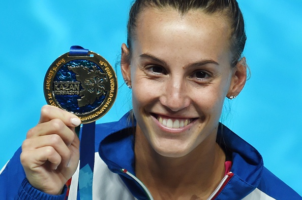 Italian diver Tania Cagnotto poses with her gold medal during the podium ceremony of the Women's 1m Springboard final diving event at the 2015 FINA World Championships in Kazan on July 28, 2015.  AFP PHOTO / CHRISTOPHE SIMON        (Photo credit should read CHRISTOPHE SIMON/AFP/Getty Images)