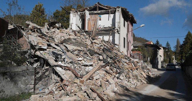A picture shows destroyed houses in the village of Borgo Sant'Antonio hit by earthquakes, on October 27, 2016 near Visso, central Italy. Twin earthquakes rocked central Italy on October 26, 2016 -- the second registering at a magnitude of 6.0 -- in the same region struck in August by a devastating tremor that killed nearly 300 people. The quakes were felt in the capital Rome, sending residents running out of their houses and into the streets. The second was felt as far away as Venice in the far north, and Naples, south of the capital. / AFP / TIZIANA FABI        (Photo credit should read TIZIANA FABI/AFP/Getty Images)